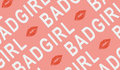 Roze French Terry stof met tekst Bad Girl
